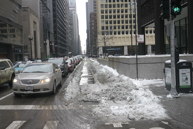 Snow in the Dearborn protected bike lane