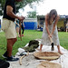 Earl Kawa'a demonstrates the creation of a papa ku'i 'ai (poi pounding board) to Smithsonian Folklife Festival visitors. Kawa'a will craft a papa ku'i 'ai  and  ku'i 'ai pohaku (poi pounder) during the festival to donate to the Smithsonian Institution.