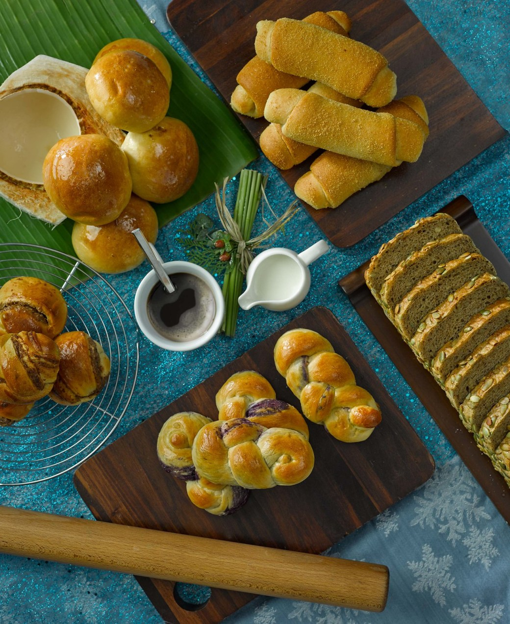 (Clockwise) Spanish Bread, Ube Twist, Mongo Bread, Pan De Coco
