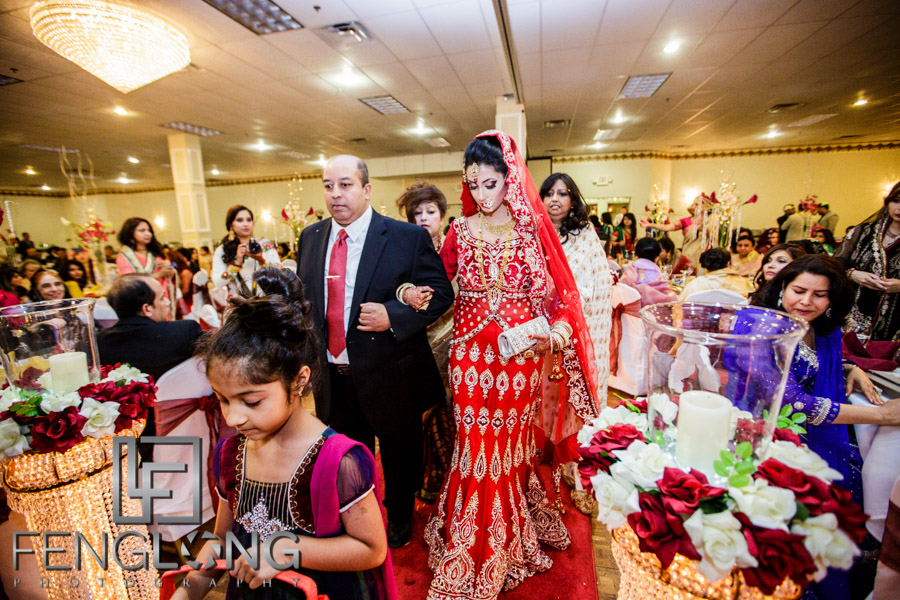 Bride makes her entrance to wedding hall