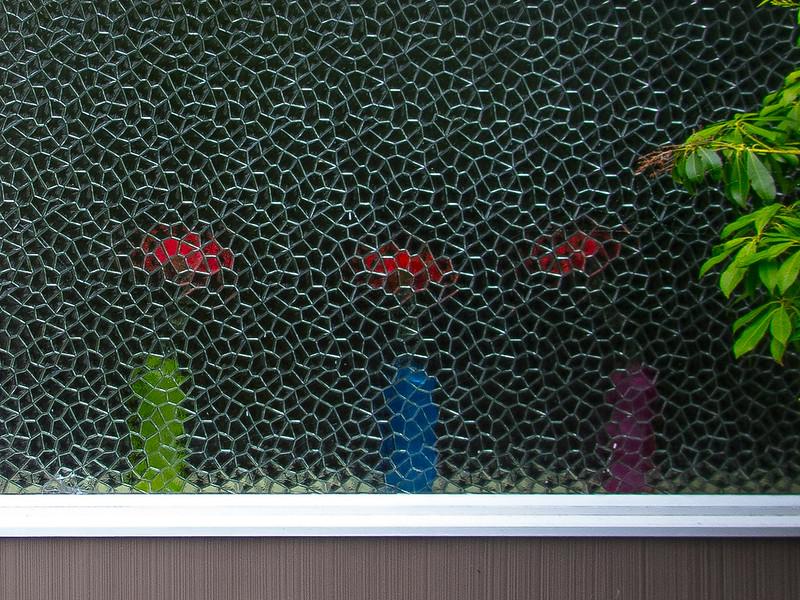 Vases Behind Textured Window