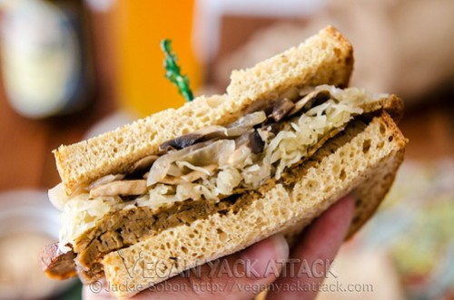 A delectably savory Seitan Sauerkraut Sandwich, complete with mushrooms, onions and horseradish sauce on toasted wheat bread!