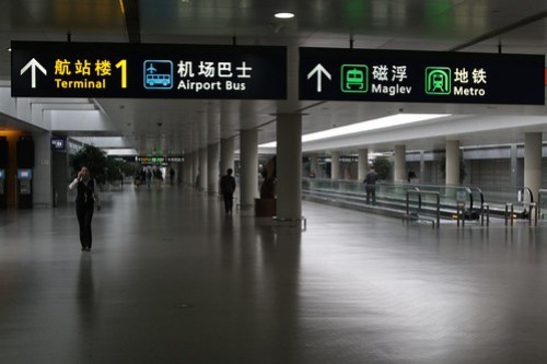 Three public transport options at Shanghai Pudong Airport - bus, maglev train, and metro train