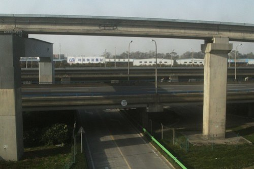 Depot track climbs above the freeway, before rejoining the main maglev line