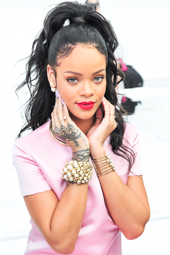 Rihanna attends the Christian Dior Cruise 2015 fashion show in Brooklyn.
