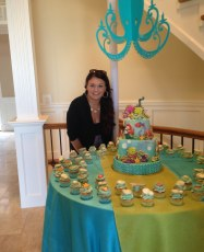 "Brandee with the ""O'Shae the Octopus"" cake and cupcakes"