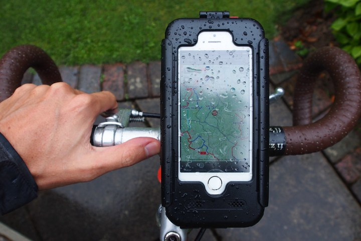 iphone mounted to handlebars