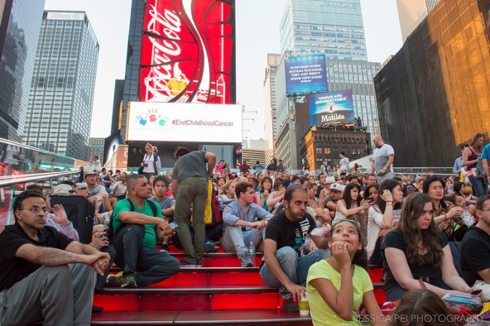 People on Red Steps in Times Square New York
