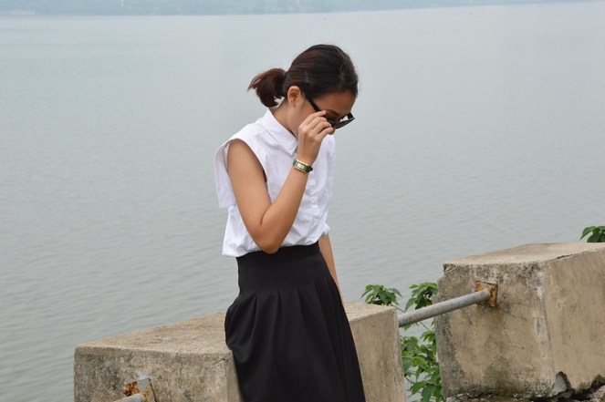 white collared blouse, green gucci watch, black midi skirt