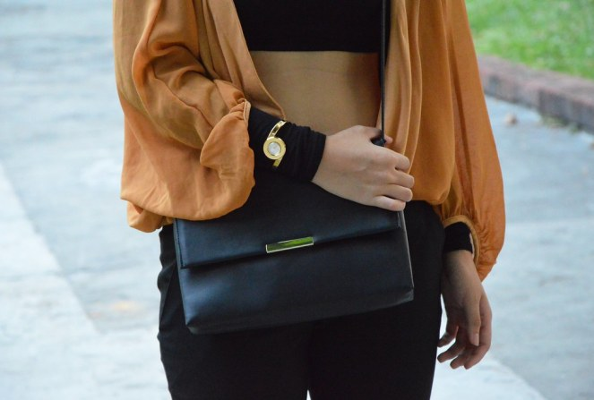 Alfex Infinity gold watch, H&M black structured sling bag