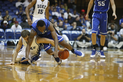 Duke point guards Greg Paulus and Nolan Smith battle for a loose ball in Saturdays Blue-White scrimmage in Cameron Indoor Stadium. Photo by Glen Gutterson/The Chronicle