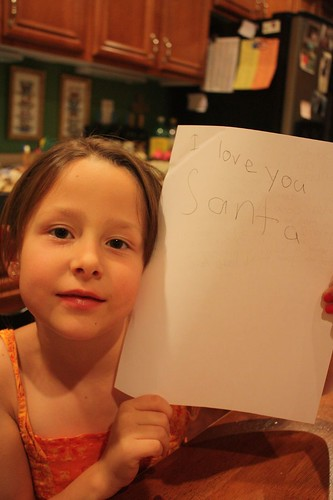 niece with extra note to Santa