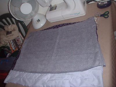 you can see the problem here. the bottom of the top is slightly A line, but the lilac hem is straight.. sew it in line with the main top so it looks all neat (as i did) and you end up with a wodge of material inside when you fold it..