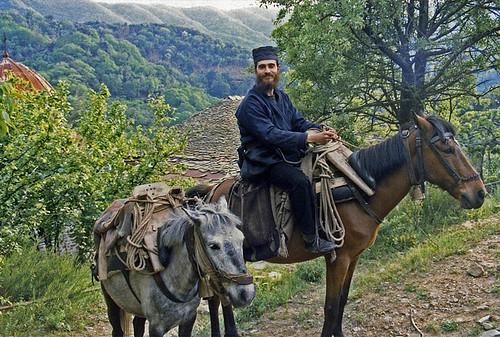 Monk on horse