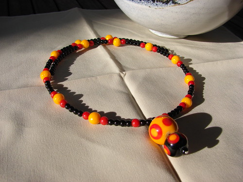 Necklace with dots pendant