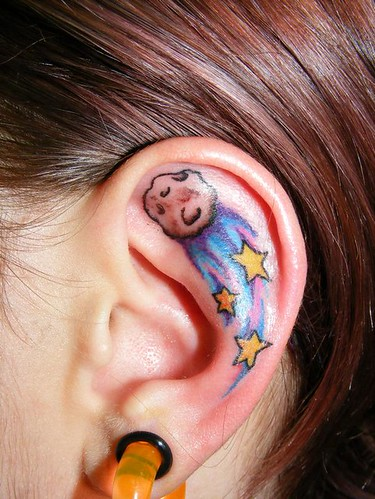 Woman Ear with Star Tattoos