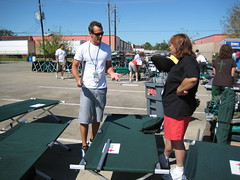 Eric Sanchez helps with cot cleanup in Texas