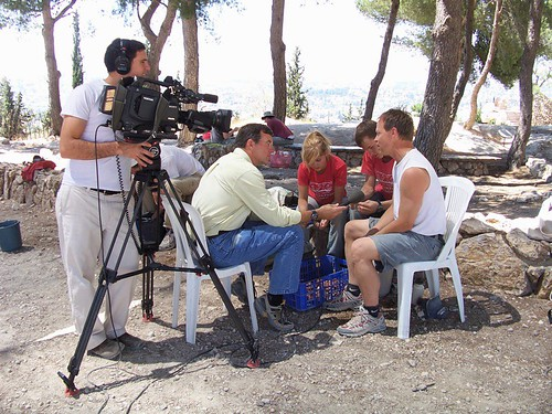 The camera crew interviewing a family of volunteers