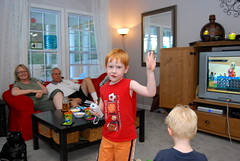Jacob coming in for a high five after Wii bowling a strike
