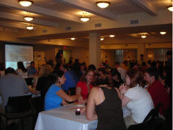 Dozens of young professionals pack the fellowship hall at Sixth & I Historic Synagogue for the start of trivia night. / photo taken by Rachel Mauro