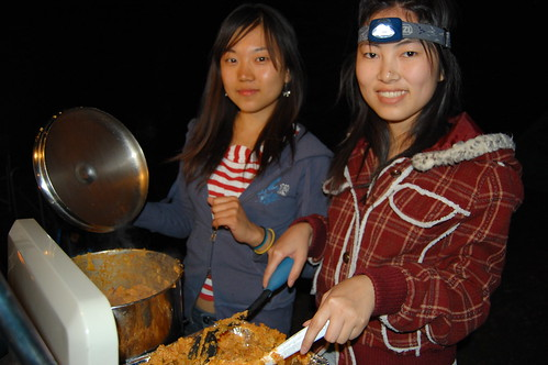 Zoe and Lauren cooking at night with a trendy headlight