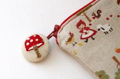 Stitched mushroom button