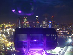 purple car and S'pore at night from above