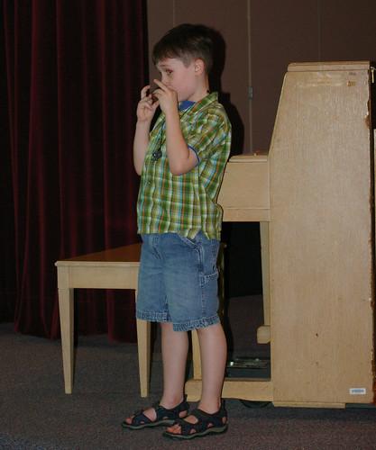 Magnus playing his ocarina at EXPO