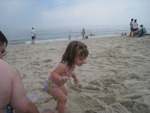 Amelia jumping in the sand