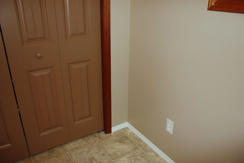 the closet doors, some of the new wall colour and the white baseboard