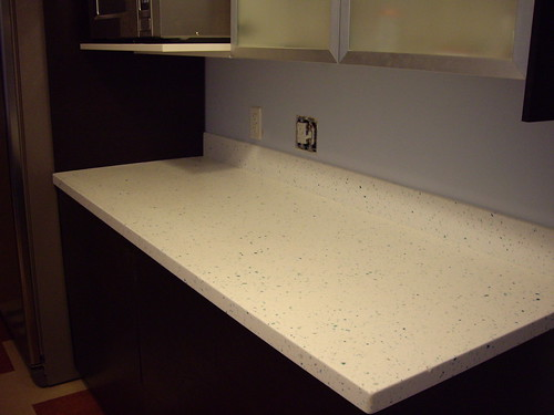Countertop next to the fridge