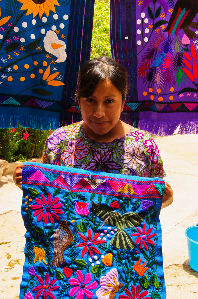 Cloth and embroiderer, Zinacantan