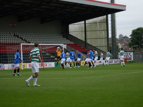 The Rangers keeper gathers a cross