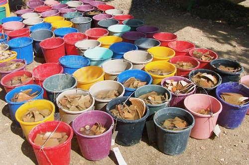 Buckets of finds waiting for pottery wash
