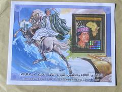 Gaddafi on a white charger