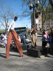 Stilt walker teaming up with an accordionist, Québec City
