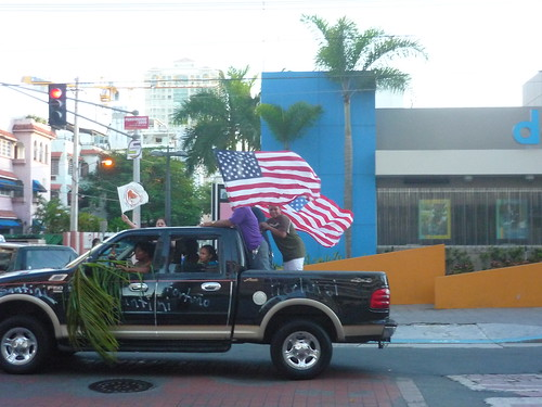 American flags flying high on Puerto Rican cars