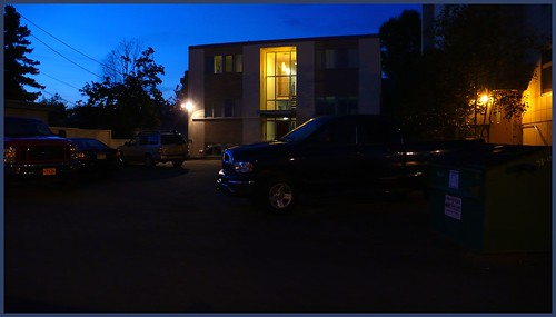 Apartment building at night, E. 7th Ave.