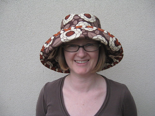 Brown floral hat by you.
