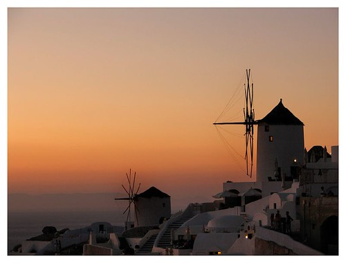 Oia windmill at sunset by you.