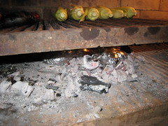 Potatoes wrapped in foil added to the embers