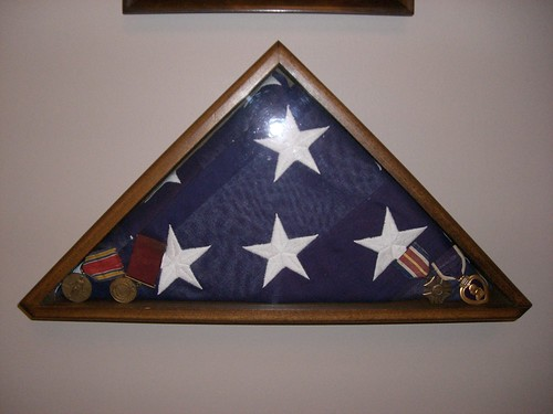 Flag from the funeral and medals
