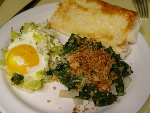 Baked eggs with leeks, swiss chard with breadcrumbs
