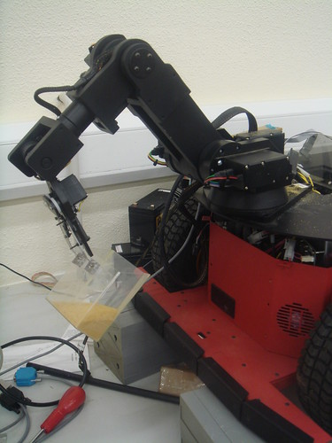 Robot arm holding a sand sample