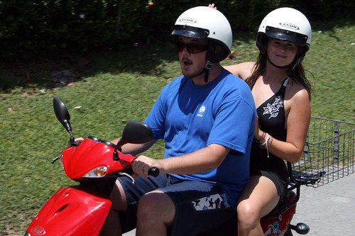 Lindsey and John, toolin' around on the moped.