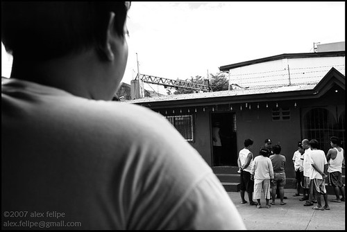 An onlooker watches the wackiness taking place at the baragay hall.