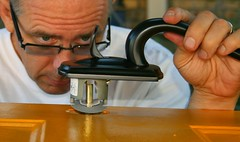 Handyman, up close, fixing a door