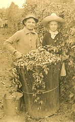 Two children with hops basket