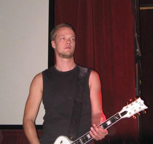 Tomi Koivusaari on guitar
