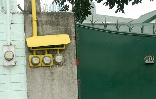 green gate with electric meters